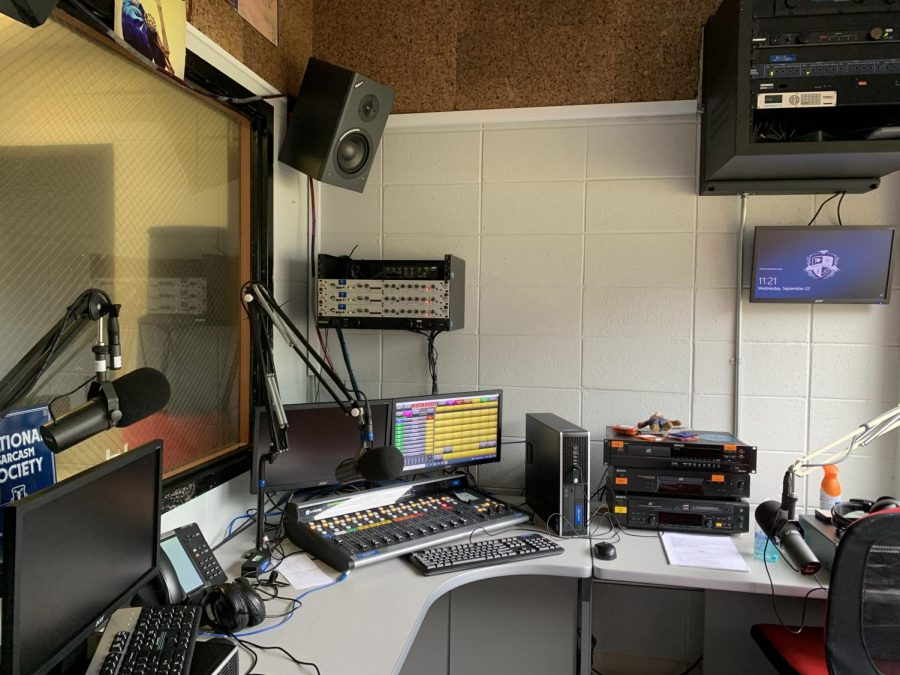 Inside view of the new WDGC radio studio and materials.