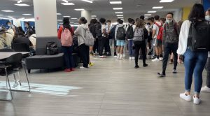 Students packed into the crowded new commons space before the first bell.