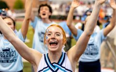 Scherquist cheers during the football game against Downers Grove North.
