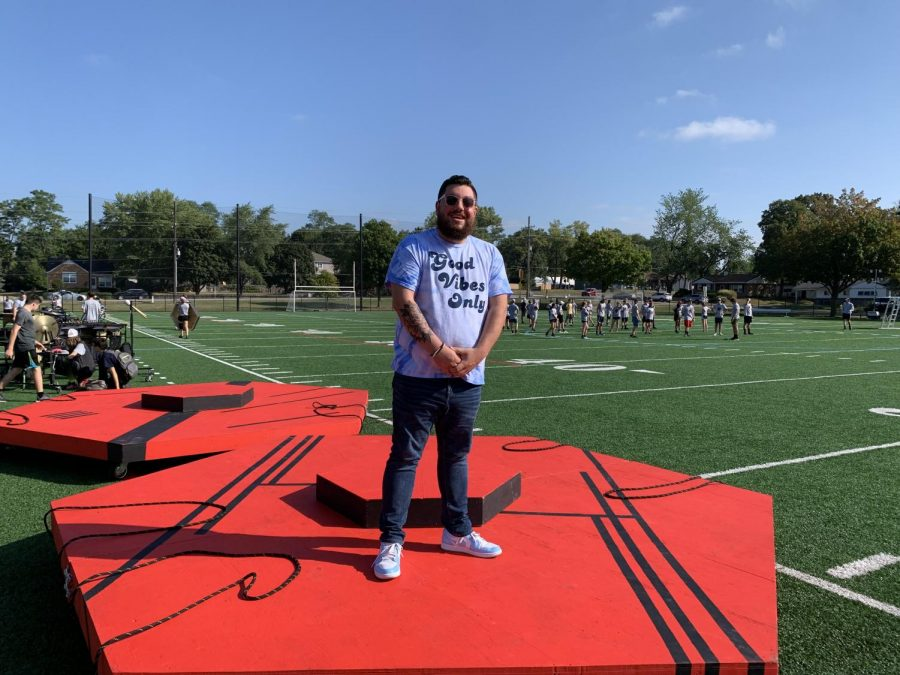 Co-band director Danny Tedeschi standing in front of the band as they get ready for their second competition at Victor J. Andrew HIgh School.