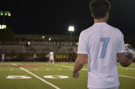 Senior Giovanni Torrijos looks sharply out onto the field, keeping the ball steady in his hands. Before the throw-in, he contemplates where the ball would be played best.