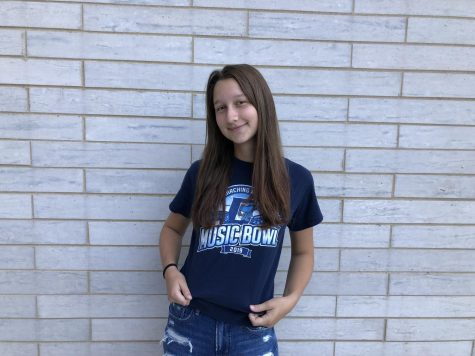 Liv Balicki, third year member of the Marching Mustangs, wears her 2019 Music Bowl shirt to show support for this years upcoming Music Bowl.