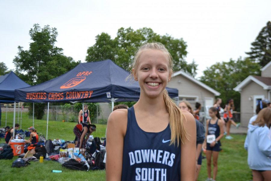 Holly Johnson smiles before her race at the Fenton Cross Country Invitational.