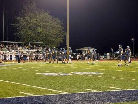 The Mustangs take the field during the Oct. 1 football game.