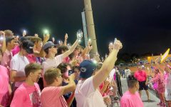 DGS student section attempts to distract the Hinsdale South football team by turning on phone flashlights.
