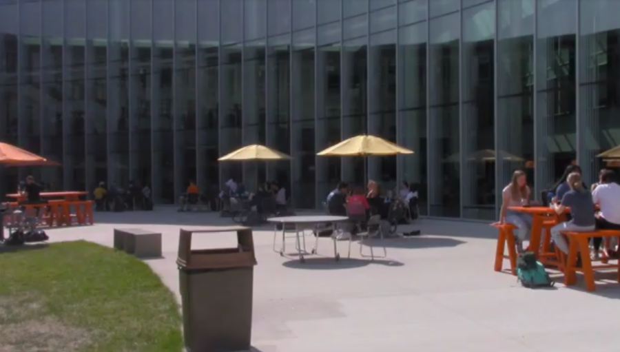 The new outdoor seating has tables with umbrellas and high-top bench options.